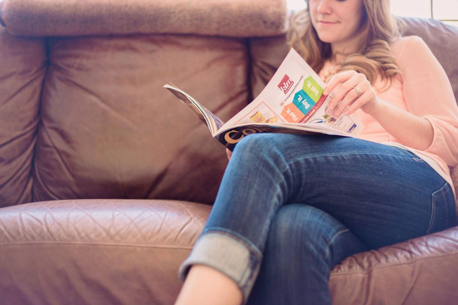 Girl reading a real estate magazine